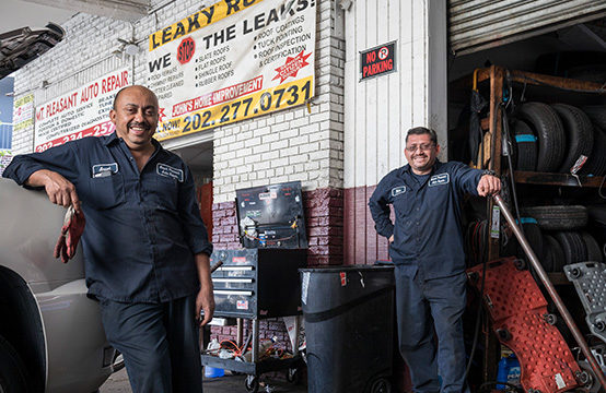 Mechanics in front of shop