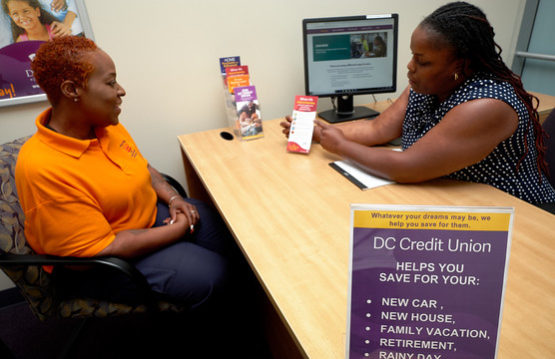 Savings consultation between DC Credit Union employee and member